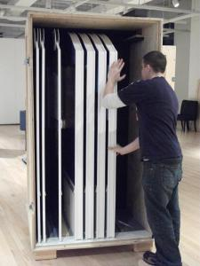 Staff member packing up exhibit components