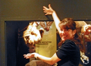 Jennifer-Lee Mason in front of the sloth exhibit in Extreme Mammals.