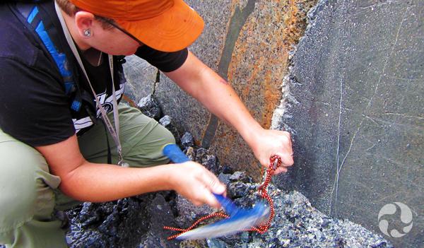 Paula Piilonen collects rock specimens in the Klåstad Quarry.