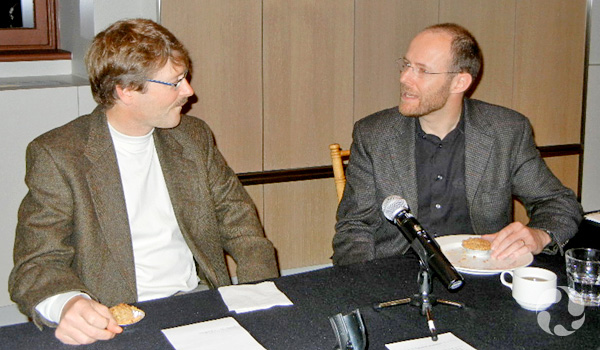 David Chernushenko and Matthew Bramley sitting at a table.