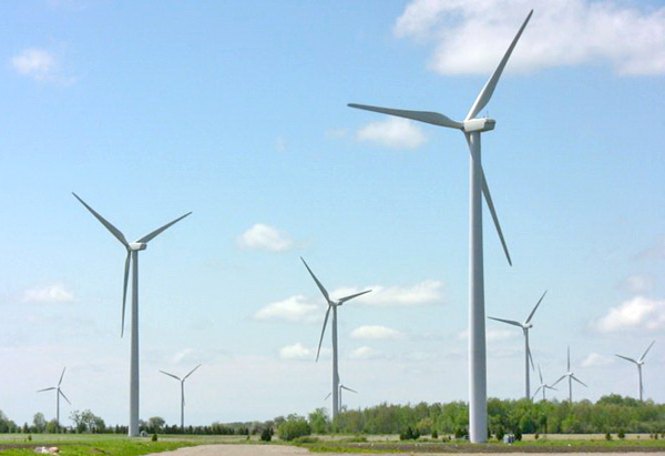 An image from the movie Powerful: Energy for Everyone, showing a field of wind turbines.