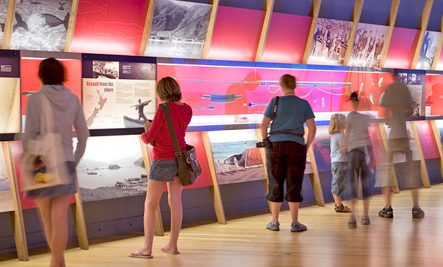 Visitors read panels in the exhibition.