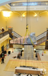 The whale skull being lifted to the fourth floor.