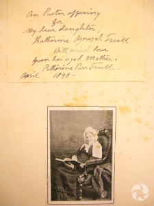 """Handwritten inscription mounted on a piece of cardboard, with by a photograph of the author. Inscription text: """"An Easter offering for my dear daughter, Katharine Agnes S. Traill With much love from her aged Mother. Catharine Parr Traill – April 1898 –""""."""