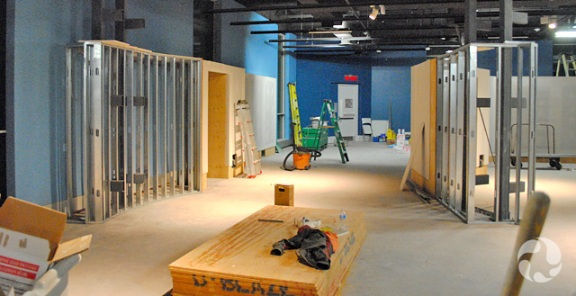 Walls under construction and building material in the new gallery space.