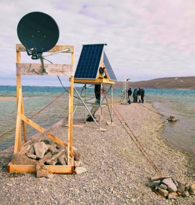 The three platforms with the satellite dish, solar panels and camera (respectively) on a rocky spit.