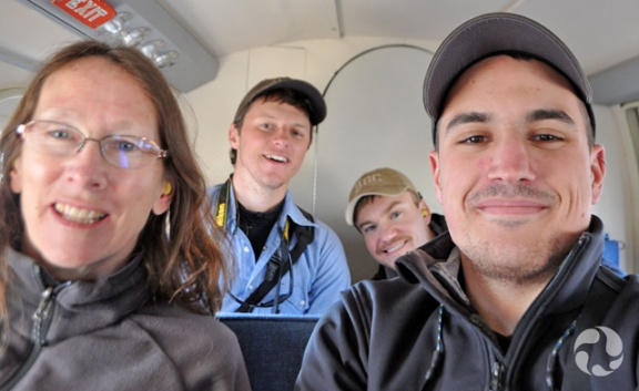 Four people in a small plane.