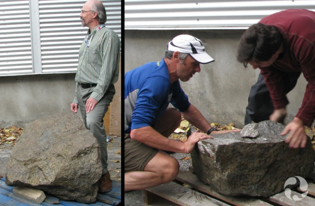 Two photos: One showing the original rock on its pallet, the other showing two people pushing the display piece onto its own pallet.