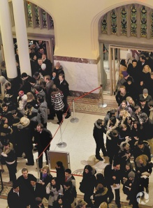 Overhead view of the line to the reception desk.