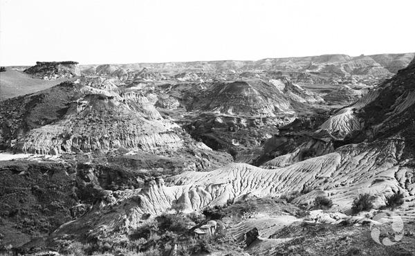 Black-and-white landscape shot of badlands of Alberta.