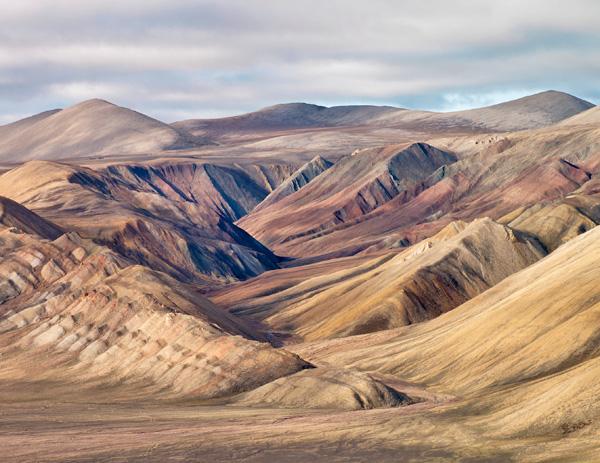 A vast, eroded, hilly landscape.