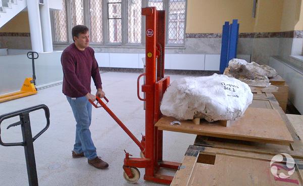 A man loads Canadian Club onto a manual fork lift.