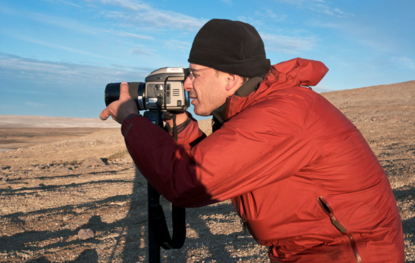 Martin Lipman looks through the viewfinder of his camera.
