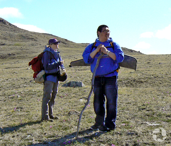 Museum curator Jennifer Doubt and guide Gary Okheena standing on the tundra.