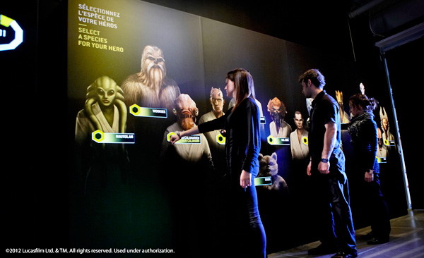 Visitors stand in front of an exhibition panel.
