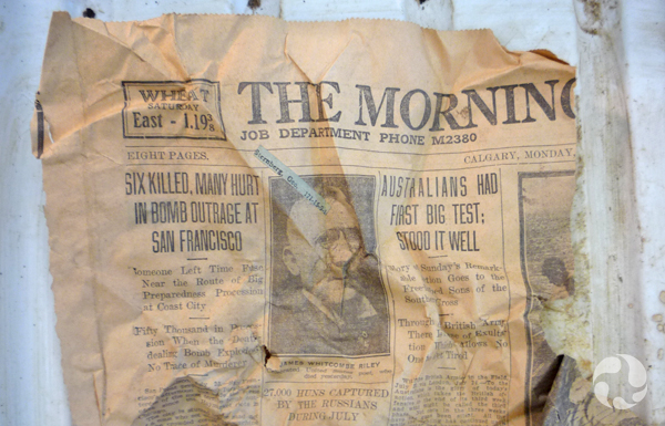 A crumpled and torn sheet of newspaper.
