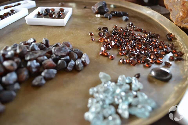 Assorted zircons displayed on a table.