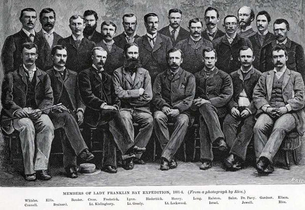 A formal studio photograph of the expedition members.