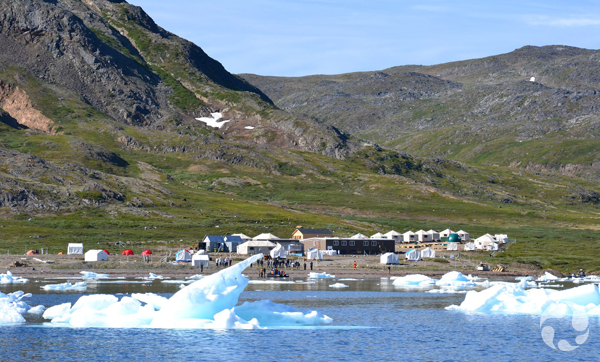 Research basecamp and buildings at edge of bay along Torngat Mountains.