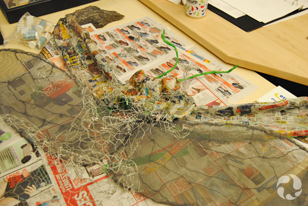 The chicken-wire structure with some papier-mâché applied.