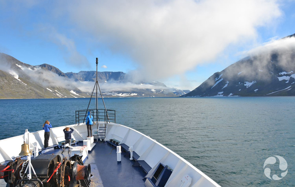 View of fiord from the bow of the expedition ship.