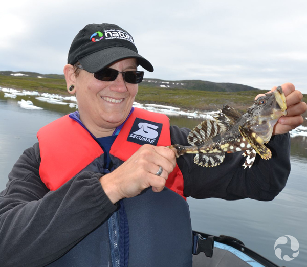 Paula Piilonen holds an Arctic sculpin caught while fishing.