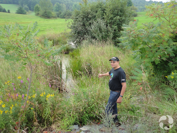 Noel Alfonso stands beside a tributary along the Hudson River.