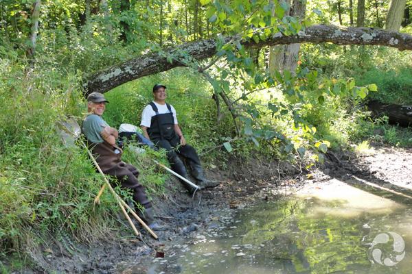 Bob Schimdt and Noel Alfonso rest along the bank of Roeliff Jansen Kill.