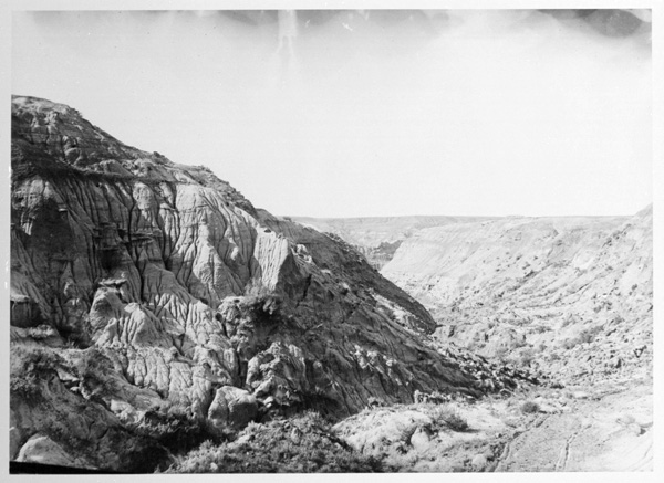 A black-and-white photo of the Badlands.