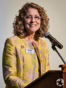 Meg Beckel at podium.