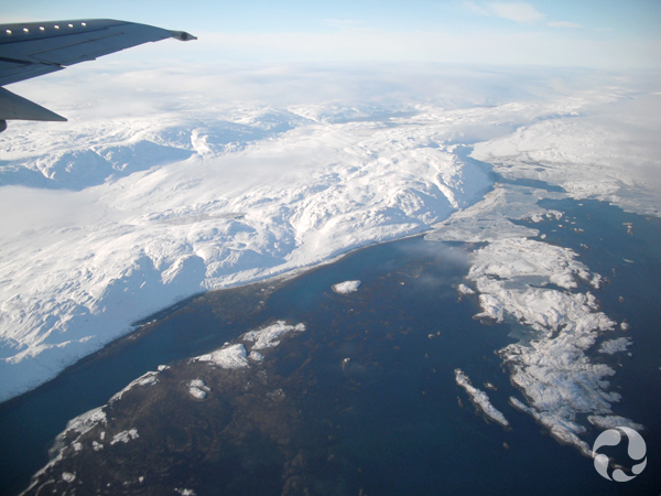 Aerial view of a snowy coastline.