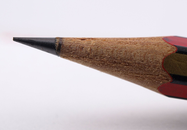The tip of a sharp pencil.