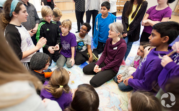 Jennifer Doubt is surrounded by eager students as they explore the floor map.