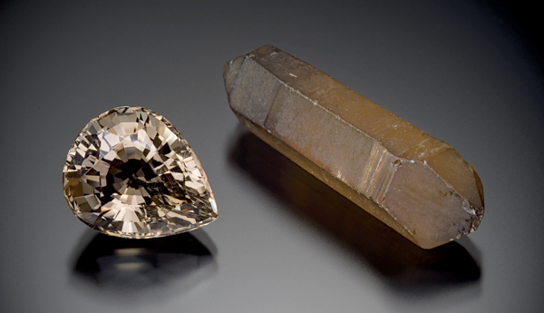 A cut gem and a natural crystal.