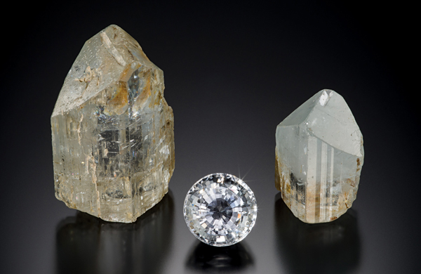 Two crystals and a cut gem.