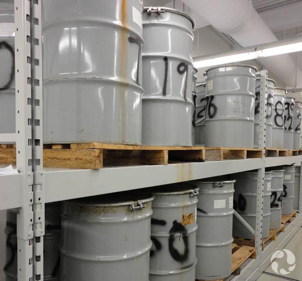 Large metal barrels on shelves.