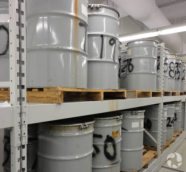 Large metal barrels on shelves.