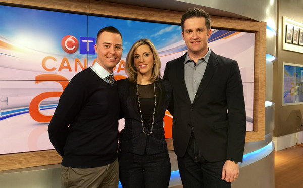 Jordan standing with Canada AM anchor Marcia MacMillan and stamp designer Andrew Perro.