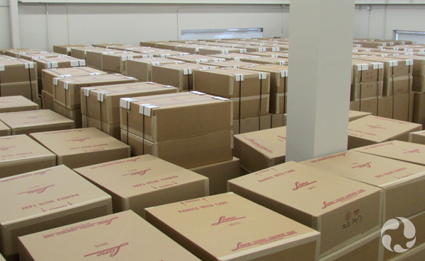 A large room filled with stacks of boxes.