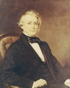 A portrait of a man sitting in a chair.