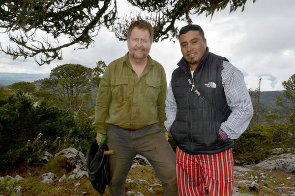 A scientist and his Guatemalan guide posing in the mountains.