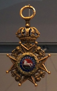 A medal in a display case.