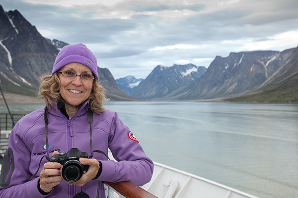 Meg Beckel on the bow of a ship in the Arctic.