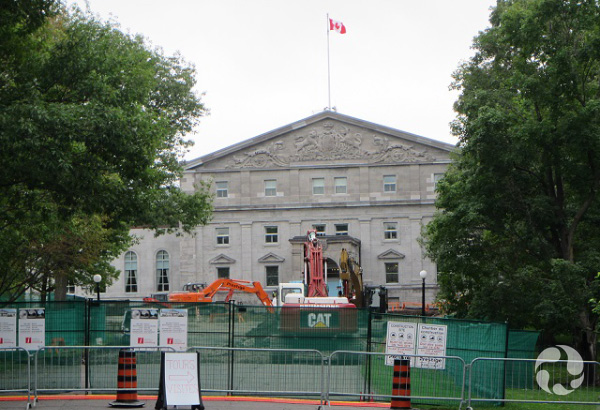 View of the building from outside temporary fencing.