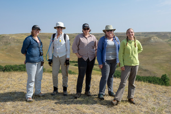 Five researchers posing for a photo in Grasslands National Park