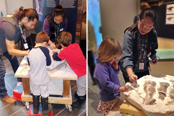 Left: A man and woman assist children at a museum activity station. Right: A young woman supervises children cleaning dinosaur fossils at a museum activity station.