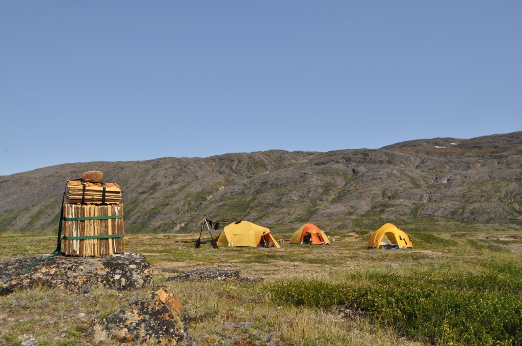 Several tents in the Arctic.