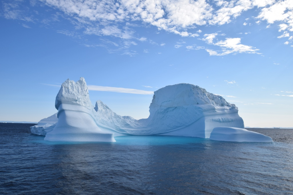 Large iceberg floating in the ocean.