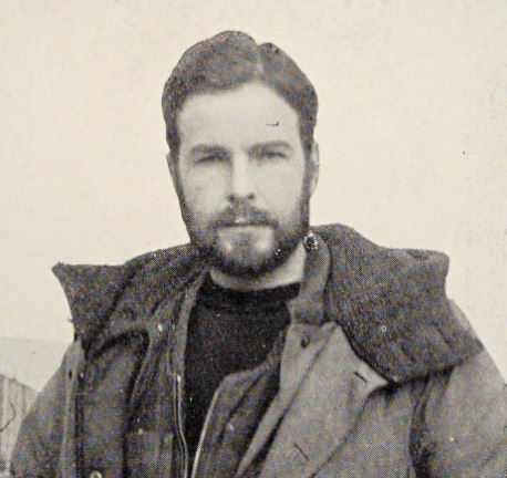 A bearded man poses in an Arctic coat.