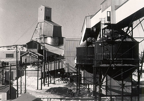 A photograph of the head frame and mill at the Director Mine, St. Lawrence Fluorspar mine, taken around 1960.